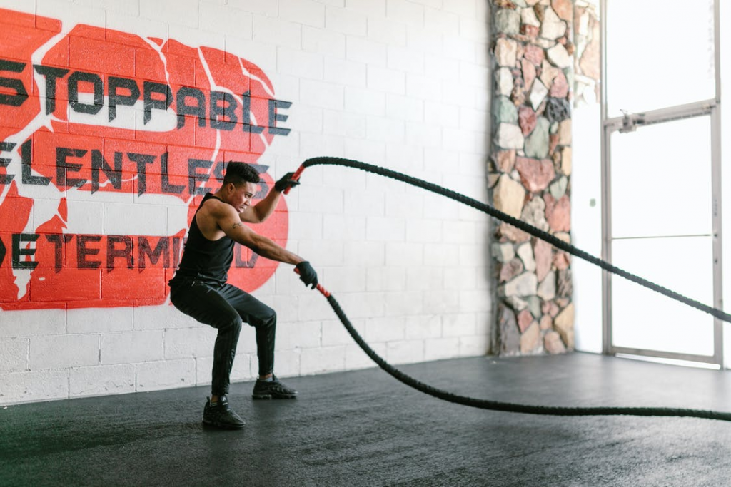 a man doing battle ropes