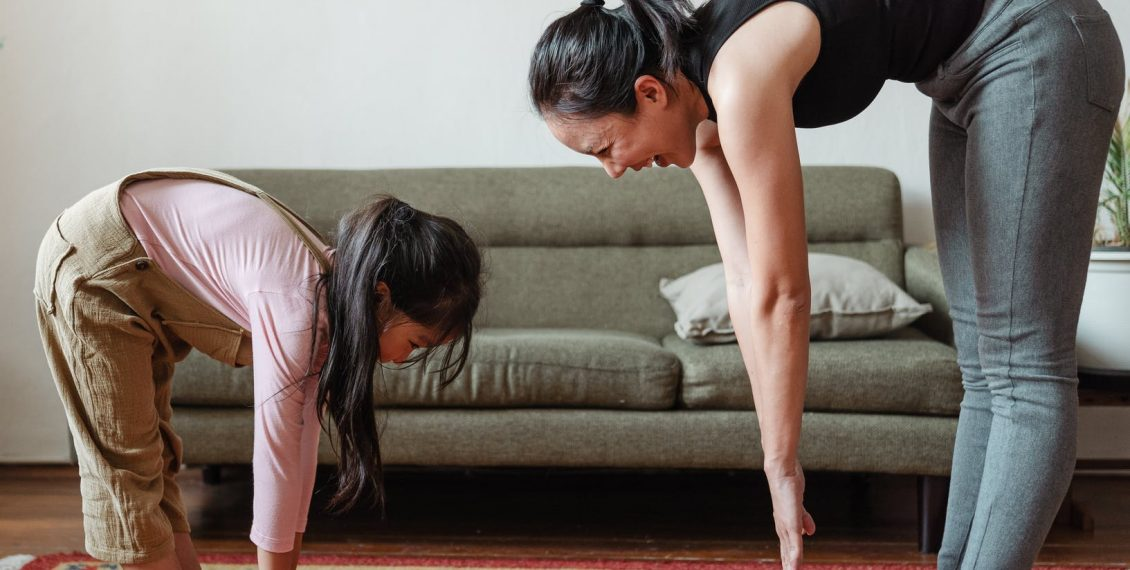 lady and a child stretching
