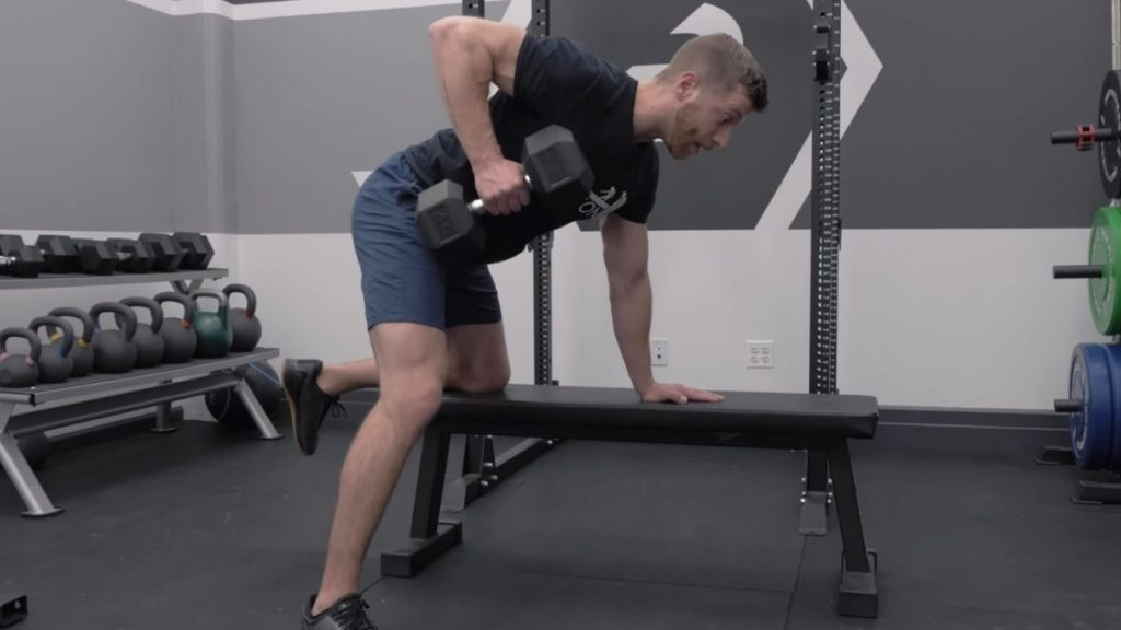A guy doing dumbbell row exercise
