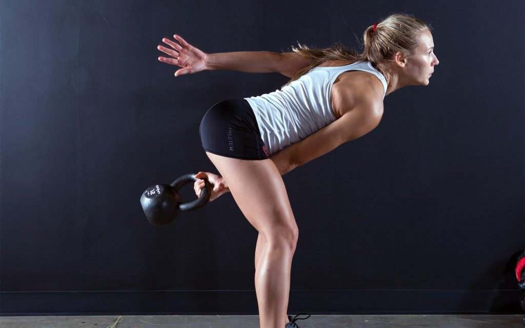 A lady doing Kettlebell Swings exercise