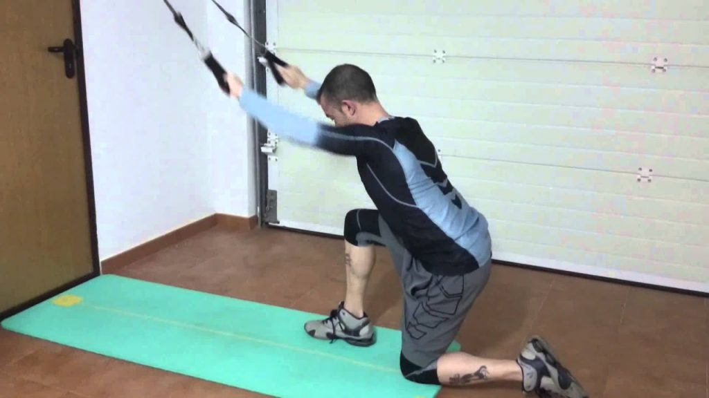 A guy doing Kneeling Resistance Lat Band Pulldown exercise