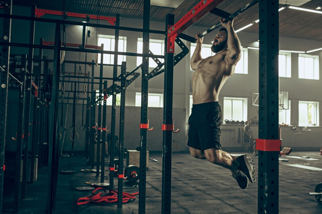 powerful attractive muscular man at gym